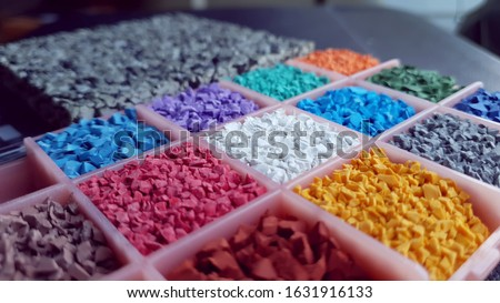 fitness rubber floor material flakes samples. colorful flakes to make unique fitness rubber flooring. Royalty-Free Stock Photo #1631916133