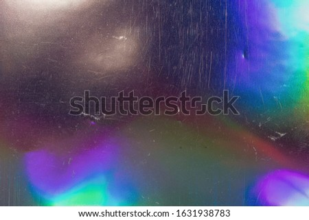 real macro photo of holographic foil. photo flash on holo material.