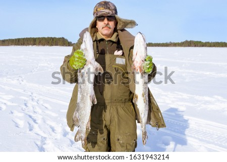 Winter, winter sports winter fishing. Trophies two large pike, fishing in winter #1631943214