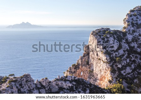 Mediterranean blue sea in the Calanques National Park - Marseille - France. White carbonate rocks and calm blue sea. #1631963665