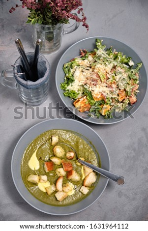 American salad with waffles and parmesan with broccoli puree soup #1631964112