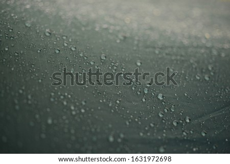 drops of water on the canvas of a tourist tent. High resolution photo. #1631972698