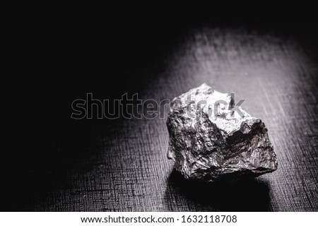Palladium is a chemical element that at room temperature contracts in the solid state. Metal used in industry. Mineral extraction concept. #1632118708