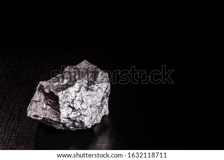 Palladium is a chemical element that at room temperature contracts in the solid state. Metal used in industry. Mineral extraction concept. #1632118711