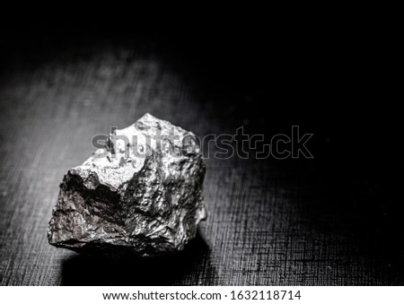 Palladium is a chemical element that at room temperature contracts in the solid state. Metal used in industry. Mineral extraction concept. #1632118714
