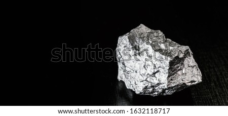 Palladium is a chemical element that at room temperature contracts in the solid state. Metal used in industry. Mineral extraction concept. #1632118717