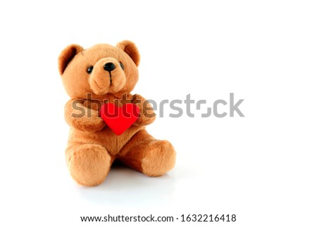 Teddy Bear Holding a heart-shaped on white background