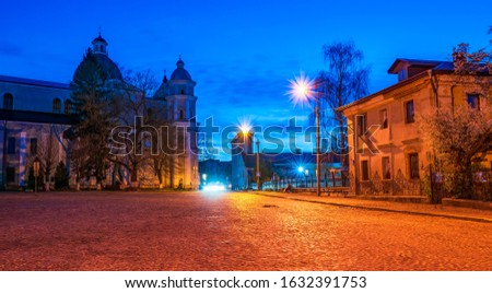 Nightscape of Castle square in Lutsk, Ukraine with Saint Peter and Paul Cathedral, Jesuit College and Convent of Daughters of Charity #1632391753