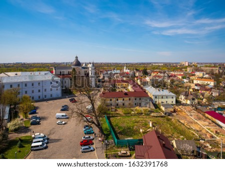 Panoramic top view of old city of Lutsk with Saint Peter and Paul Cathedral, Jesuit College, Convent of Daughters of Charity and Castle square from top of Lubart's Castle Tower. Lutsk, Ukraine #1632391768