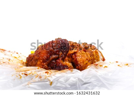 "A picture of ""nasi kandar ketagih"" with curry been add in plastic and white background. One of Malaysia food should try"