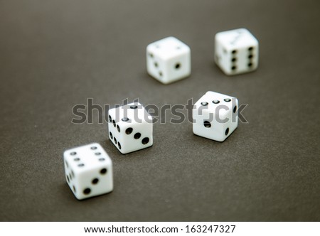 Five dice on a dark table #163247327