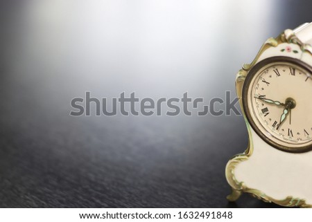 Vintage clocks placed on a black table with space for placing things in the morning. #1632491848