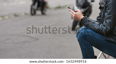 Beautiful young hipster woman using smart phone Royalty-Free Stock Photo #1632498916
