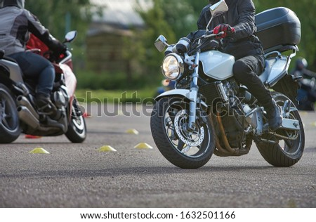 The biker in action or movement, riding around a curve road. Royalty-Free Stock Photo #1632501166