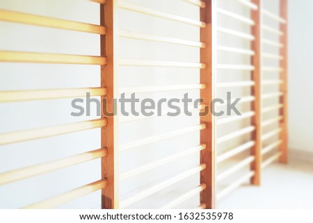 Healthy lifestyle background - close-up of wall bars in the school gymnastic hall ( selective focus)