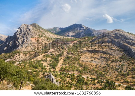 Panoramic view onto Taurus mountains & montane valleys in Kahta district, Turkey. Picture taken from mountain in ancient city Arsameia