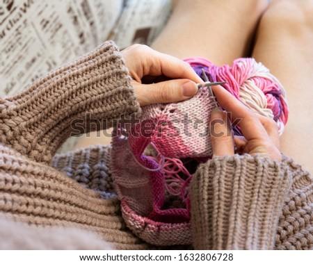 Knitting on knitting. Hands close-up knitting on knitting needles. #1632806728