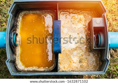 Grease traps box in the house, fats oils and grease.Concept waste water treatment Royalty-Free Stock Photo #1632871102