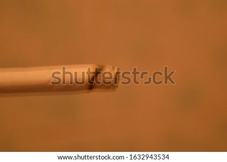 Blur defocus bokeh the cigarette #1632943534