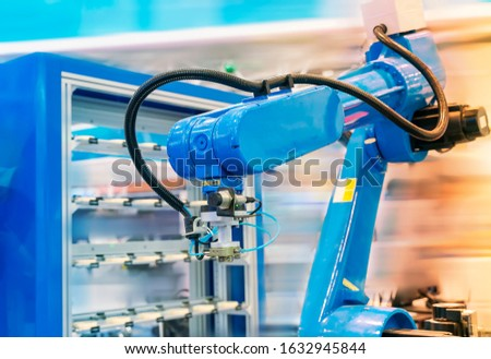 Automation system control application on automate robot arm in smart manufacturing background. #1632945844