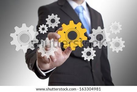 Businessman solution cogwheel concept #163304981