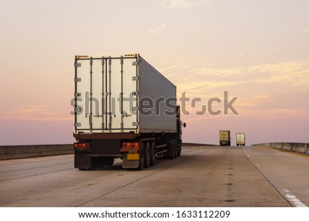 White Truck on highway road with  container, transportation concept.,import,export logistic industrial Transporting Land transport on the asphalt expressway #1633112209