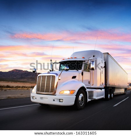 Truck and highway at sunset - transportation background #163311605