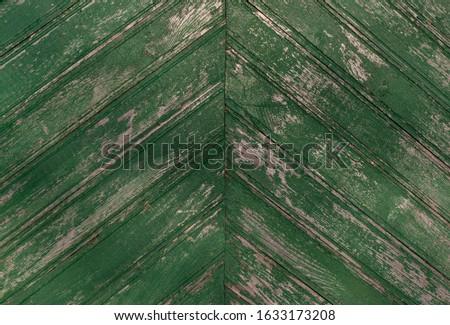 old weathered wood texture painted green color. herringbone pattern. #1633173208