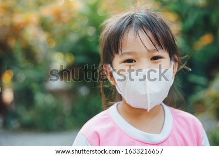 Kids wearing the mask for protect them self from virus and air pollution. Prevention by mask to reduce spread of the coronavirus (covid-19) outbreak from human to human transmission. #1633216657