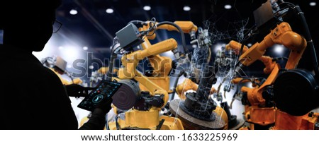 Factory Female Industrial Engineer working with automation robot arms machine in intelligent factory industrial on real time monitoring system software.Digital future manufacture. #1633225969