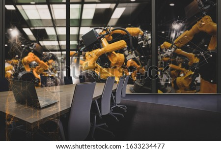 Factory Industrial Engineer office with automation robot arms machine in intelligent factory industrial on real time monitoring system software.Digital future manufacture in meeting room. #1633234477
