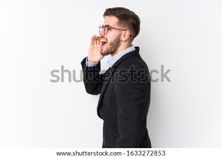 Young caucasian business man posing in a white background isolated Young caucasian business man shouting and holding palm near opened mouth. #1633272853