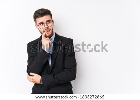 Young caucasian business man posing in a white background isolated Young caucasian business man relaxed thinking about something looking at a copy space. #1633272865