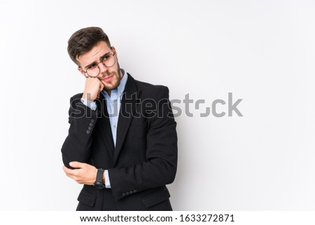 Young caucasian business man posing in a white background isolated Young caucasian business man who feels sad and pensive, looking at copy space. #1633272871