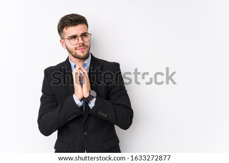 Young caucasian business man posing in a white background isolated Young caucasian business man making up plan in mind, setting up an idea. #1633272877