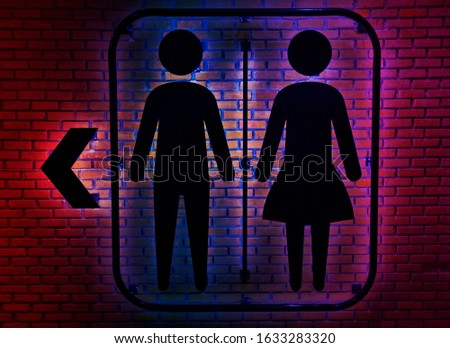 Restroom sign on a toilet dooron wall background.Toilet sign - Restroom Concep.Toilet icons set.
