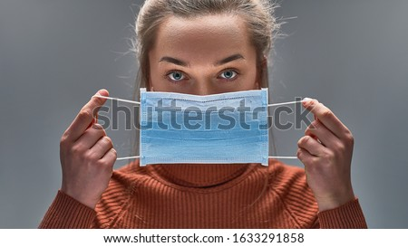 Healthy woman using medical protective mask to health protection and prevention from flu virus, epidemic and infectious diseases Royalty-Free Stock Photo #1633291858