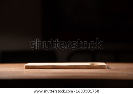 empty wooden tray wooden table with dark isolate background stock photo