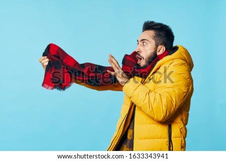 man with a warm scarf in a warm jacket #1633343941