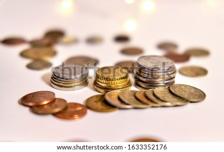 Coins stacked in stacks on a colored background with a side #1633352176