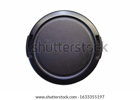 Protecting cup. Lens cover. Black cup covering lens. lens protecting item. #1633355197