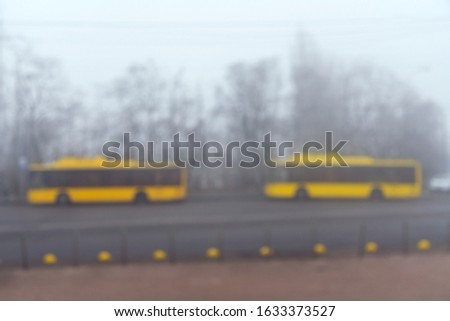 Yellow buses in the fog. Yellow school buses in a foggy haze. blurry #1633373527