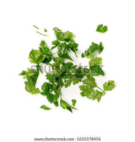 Fresh green chopped parsley leaves isolated on white background. Spicy aromatic sliced raw herbs of garden parsley. Cilantro or corriender leaves pieces top view #1633378456