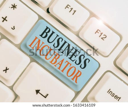 Conceptual hand writing showing Business Incubator. Business photo text company that helps new and startup companies to develop. #1633416109