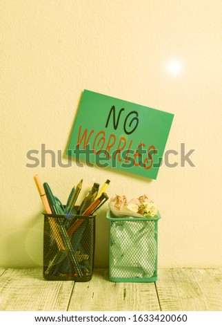 Text sign showing No Worries. Conceptual photo an expression used to say that everything is all right Blue Sticky Card on Wall Two Pencil Pots Pens Pencils Markers Waste Paper. #1633420060