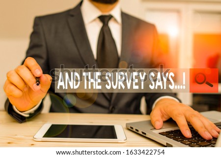 Text sign showing And The Survey Says. Conceptual photo written spoken results of short quiz or exam on internet Male human wear formal clothes present presentation use hi tech smartphone. #1633422754