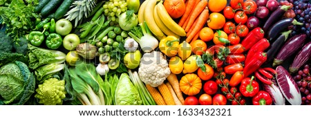 Panoramic food background with assortment of fresh organic fruits and vegetables in rainbow colors Royalty-Free Stock Photo #1633432321