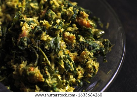 Urap is a salad dish in the form of cooked vegetables mixed with grated coconut flavored as a flavor giver. Urap different name also urab or urap-urap #1633664260