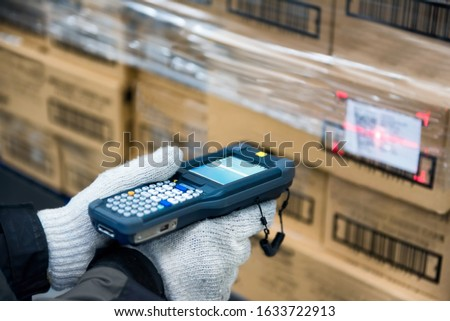 Bluetooth barcode scanner checking goods in the cold room or warehouse. Royalty-Free Stock Photo #1633722913