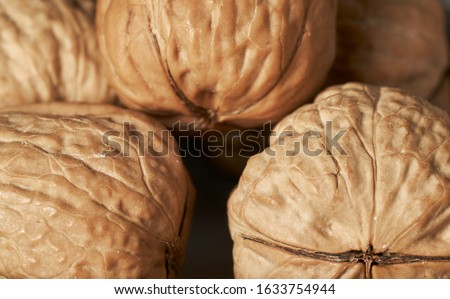 walnut and a cracked walnut closeup shot Royalty-Free Stock Photo #1633754944